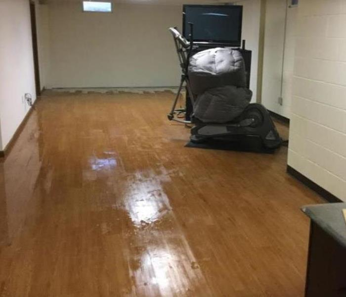 water damage on hardwood floor in residential basement