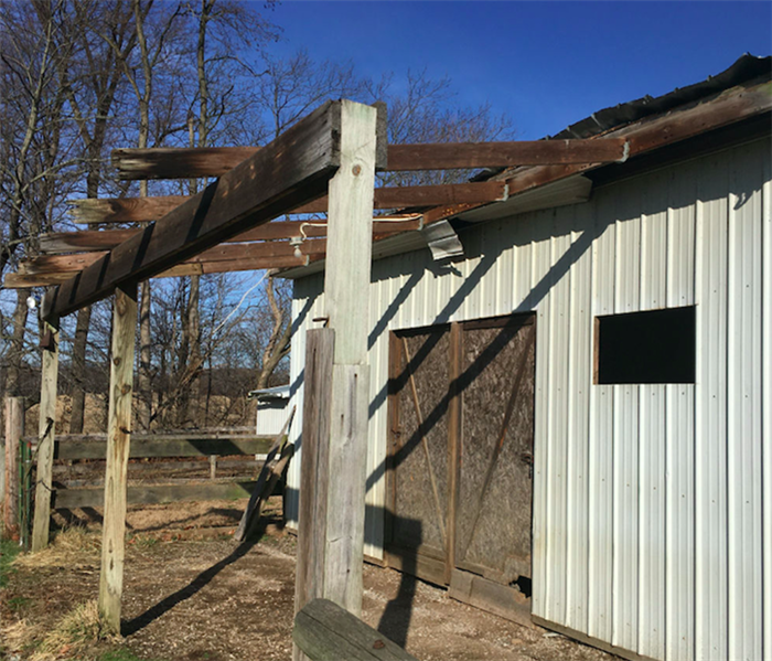 barn roof damaged due to wind