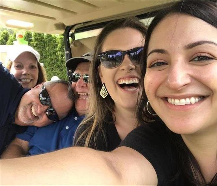 Marketing Team Golfing With Clients
