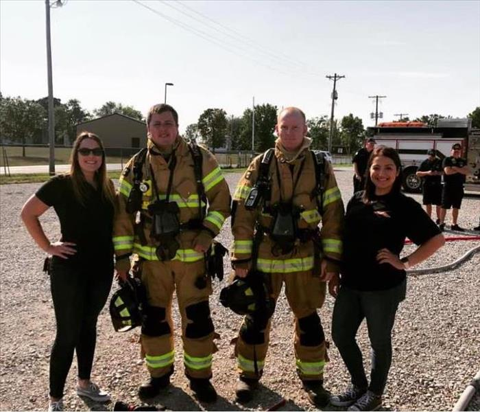 two females with two male Firefighters