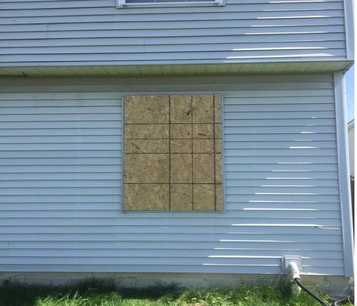 wood over window on back of house