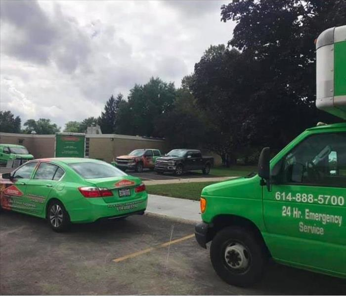 SERVPRO vehicles in parking lot outside school