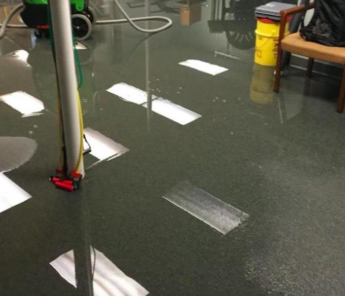 water covering therapy room floor in commercial building